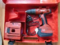 HILTI SF 180-A DRILL WITH BATTERY, CHARGER AND CASE.
