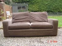Brown Fabric Two Seater Sofa. Can Deliver.