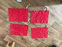 4 red corner flags
