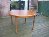 Extending Teak Circular Dining Table & Chairs