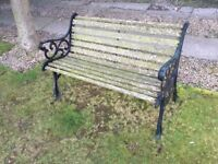 Three wrought iron garden benches