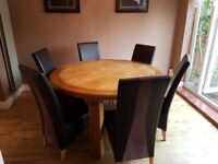 Solid oak round dining table 6 brown leather & suede chairs