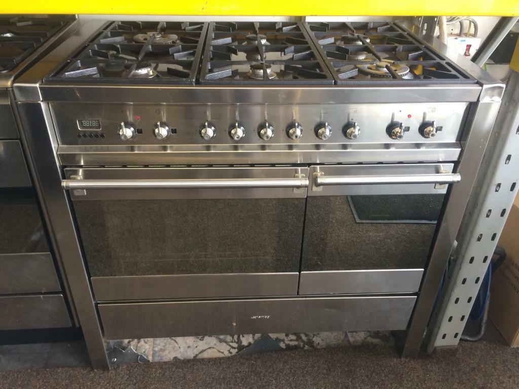Stainless steel smeg 100cm six burners dual fuel cooker grill & double fan ovens with guarantee