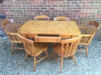 Solid chunky pine farmhouse dining table with drawer. Plus 6 Chairs