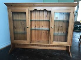 Solid pine display cabinet with glass shelves and display lights