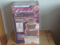 Stainless steel hand juicer (Bake off Cake dec stand, Stainless steel Choc Fountain All unused.