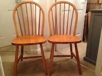 Two wooden dining chairs - pine dining chairs