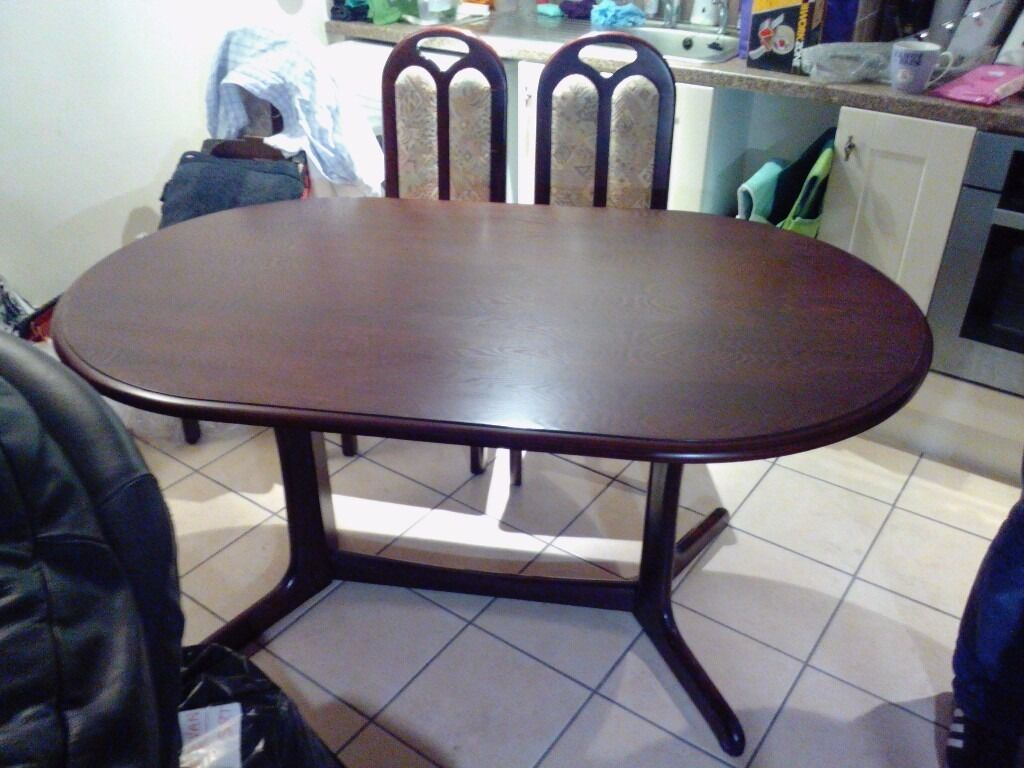 Dark wood table+4 chairs,very good condition.may deliver locally,£80 ovno.