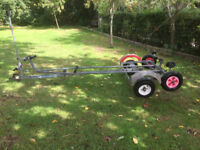 Snipe boat road trailer and combined launching dolly