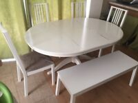 White Ikea extendable dining table with chairs and bench