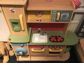 Children's kitchen with 2 boxes of food