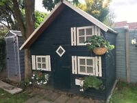 2 storey wooden playhouse with 2 beds/storage inside + play space.