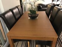 Extendable wooden table and 6 high back chairs with matching sideboard