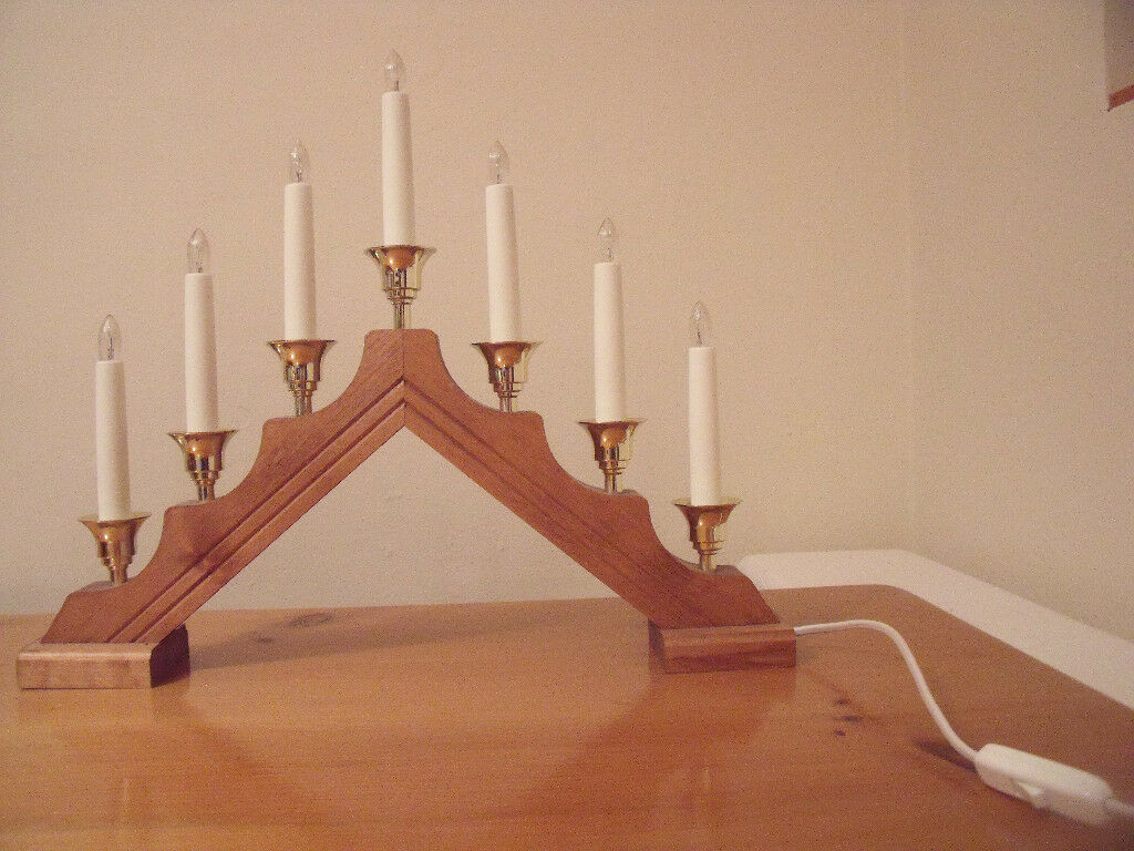 Konstsmide Design mains 7 candle Christmas oak stain/brass bridge/arch in original box. £8 ovno.