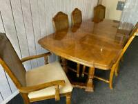 Wooden extending dining table and 6 chairs with 2 carvers