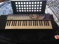 Yamaha PSR 74 Electric Keyboard and Gig Bag