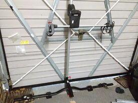 Servo assisted car roof bike carriers
