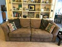 Large sofa with pouffe and chair.
