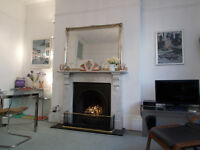 Delightful, light and airy 1 bedroom holiday apartment with garden close to the sea front and town