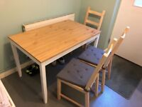 Dining table and 4 chairs, with 4 seat cushions. Excellent condition, non smoking home
