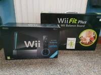 Black Wii with Wii fit plus board