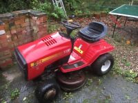 Red sit on mower Rally 12 Hp