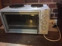 Small electric counter top oven with double electric hob.