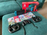 Nintendo Switch console, 5 games and accessories
