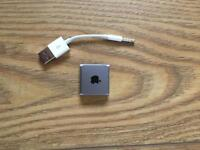 iPod shuffle 2GB with charger lead.