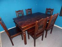Dining table and 6 chairs with cushions