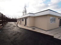 Modern gated 1 bed bungalow with patio in Woodford Green