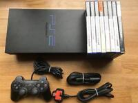 PlayStation 2 console with driving games. Ps2