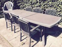 Large patio/outdoor dining table and 10 chairs