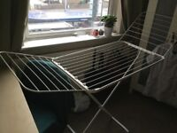 Clothes rack and laundry basket