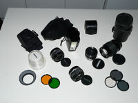 Olympus OM set (lenses 28mm + 50mm + 135mm + tele converter + flash unit + filters + bag)