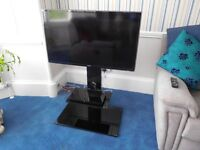 "TV Stand for 40"" TV. Strong steel construction with 2 Glass shelves. Quite a heavy item"