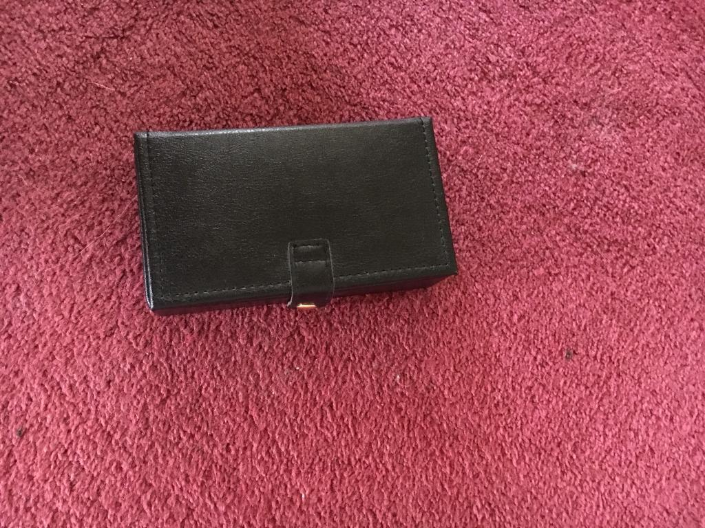 Small black leather jewellery case