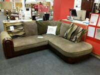 Corner sofa upholstered in brown fabric and brown leather - British Heart Foundation