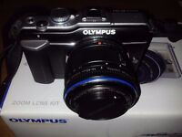 Olympus Pen EPL1 with 14-42mm kit lens
