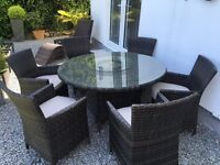 Rattan and glass 6-seater outdoor 130cm round table and chairs