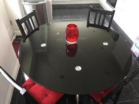 Harveys Glass RoundTable - Black top. 4 seater. (Without chairs)