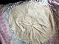 Cream circular baby shawl