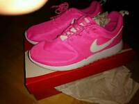 Brand new women's pink Nike roshes size 4