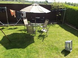 4 Garden chairs glass table and good parasol