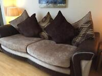 4 Seater sofa with swivel chair and storage footstool.