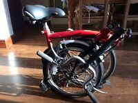 Red Brompton bike Excellent condition only been used once.