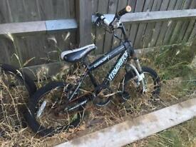 Scrap, two boys push bikes