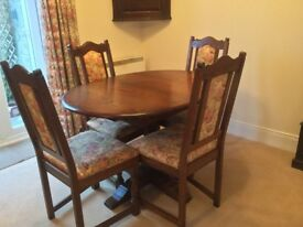Old Charm extending dining table, four chairs and sideboard