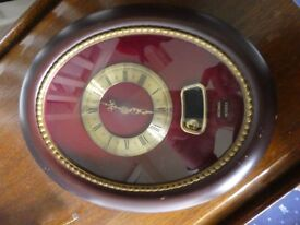 Clock - Battery operated electric motion, c/w additional pendulum motion