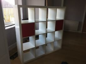 Ikea expedit unit with 2 red cupboards